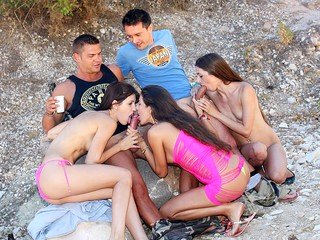 Wild girls fuck on the beach