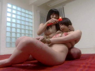 Mayura and Kasumi drip candle wax while bound